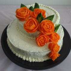 Carrot Cake with Carved Carrot and Cucumber Flowers